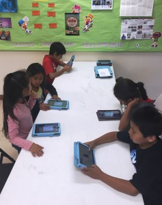After-school students learn math facts using e-Carrot tablets.