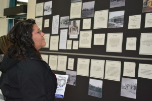 Chelsea O'Daye, a member and an employee of the Reno-Sparks Indian carefully reviews the pictorial timeline for the Colony's last 80-years. Over 300 people participated in the RSIC's 80-Years of Sovereignty on Jan. 15, 2016.