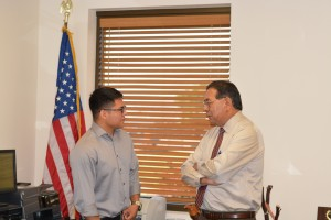 U.S. Specialist Zack Imus visits with RSIC Chairman Arlan D. Melendez.